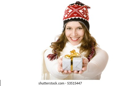 Young happy woman with cap is holding Christmas gift in hands. Isolated on white background with copyspace for your ad.