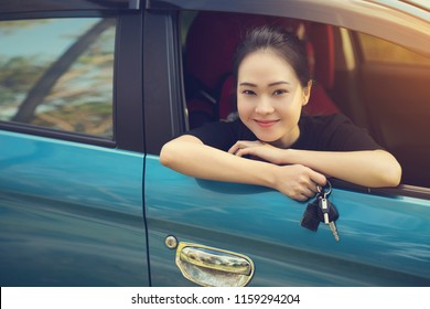 young happy woman in car with sunlight, car rental or travel insurance concept