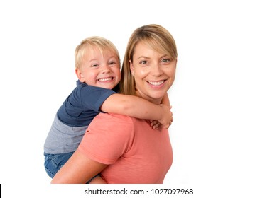 young happy woman carrying her adorable 3 years old  little boy on her back smiling happy and cheerful in family mother and son together concept isolated on white background