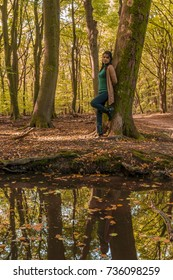 young happy woman in casual clothes at the autumn fall forest , Speulderbos Veluwe Netherlands