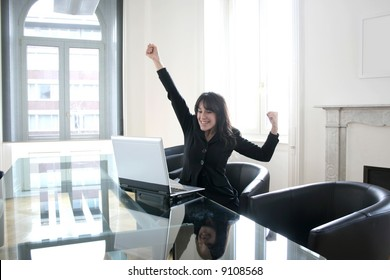 Young happy  woman at the computer