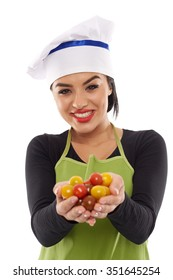 Young happy woman cook holding a bunch of cherry tomatoes