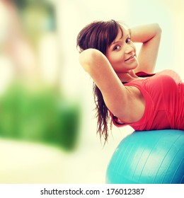 Young happy woman doing fitness exercise at home