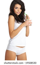 Young happy woman drinking milk