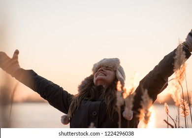 Young happy woman enjoying the winter season