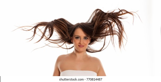young happy woman with flying hair on white background