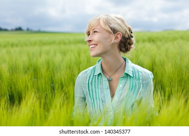 young happy woman in grassland test test