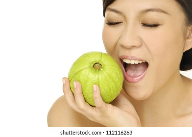 young happy woman with green guava fruit