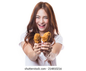 Young happy woman  holding and eating fries chicken on white background