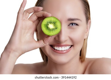 young happy woman holding a fresh kiwi  on white