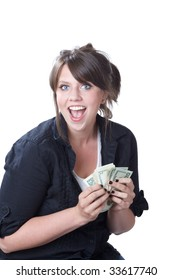 Young, happy woman holding money in her hands; isolated on a white background.