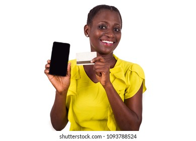 young happy woman holding a new credit card and showing mobile phone screen shopping online