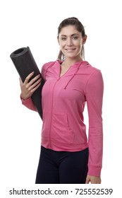 young happy woman holding a yoga mat under her arm
