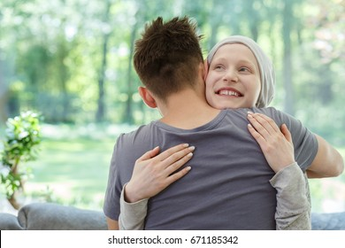 Young happy woman hugging her husband after successful therapy