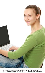 Young happy woman with a laptop sitting on the floor