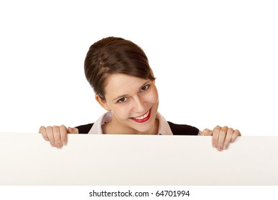 Young happy woman looks smiling above blank advertisement board. Isolated on white background.