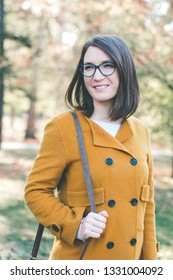 Young happy woman portrait outdoors in autumn
