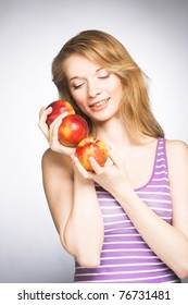 Young happy woman with red peaches