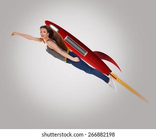 Young happy woman riding drawing a cartoon rocket.