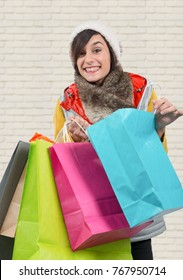 a young happy woman with shopping bags