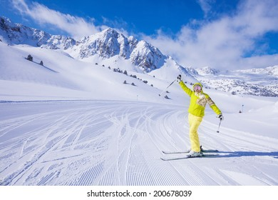 Young happy woman skier stand with lifted from excitement hands on the piste