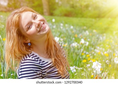 Young, happy woman in the spring sun