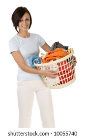 Young happy woman standing with full laundry basket. Looking at camera. Front view, white backgroun.