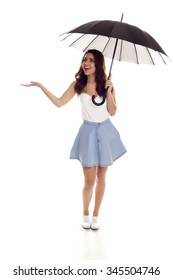 Young happy woman with umbrella over white background.