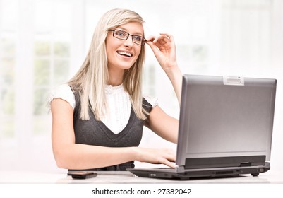 Young happy woman using notebook