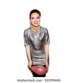 Young happy woman wearing silver dress and holding pink balloon on white background not isolated