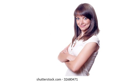 Young happy woman in white shirt  with hands near hip
