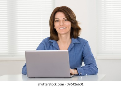 Young Happy Woman Working On Laptop At Home