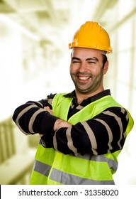 young happy worker portrait with arms crossed