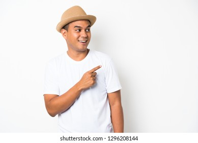 Young happy&funny asian man pointing finger on blank space for text.