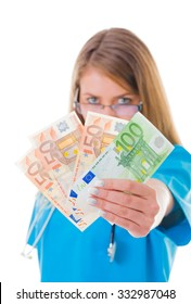 Young healthcare worker with 250 Euro in her hands looking at the camera.