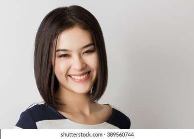 Young healthy Asian short hair woman with smiley face.