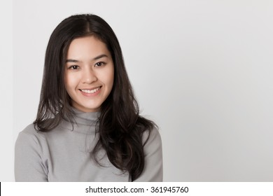 Young healthy Asian woman with smiley face.