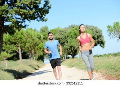 young healthy couple running outdoor in summer during a fitness exercise