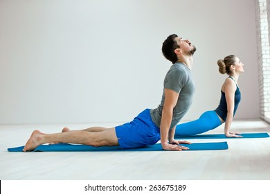 Young healthy couple in yoga position
