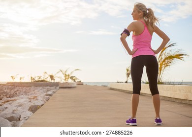 Young healthy fit woman ready for fitness exercise outdoors