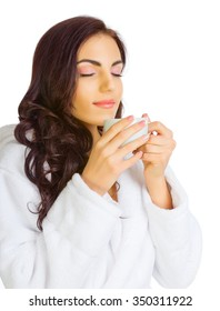 Young healthy girl with bathrobe and cup isolated