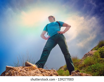 young healthy man hiking in the mountains