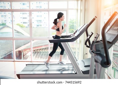 young healthy and sporty woman workout in gym