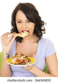 Young Healthy Woman Eating Cold Cooked Chicken Legs