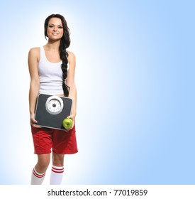 Young healthy woman over blue background