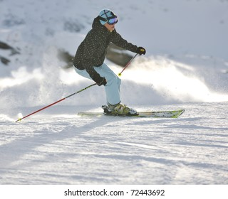 young healthy woman skiing on fresh snow at winter season in france alps