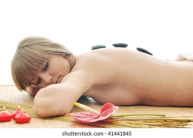 young healthy woman in wellness and spa studio have Massage with hot volcanic stones
