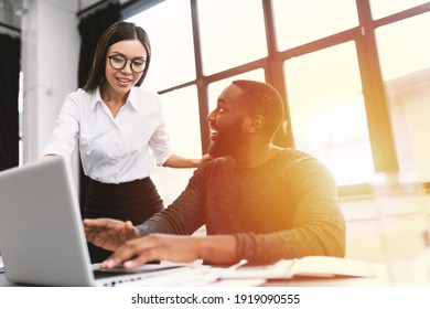 Young and heterogeneous co-workers working with pc in the office