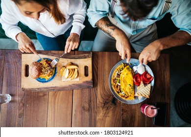 Young heterosexual couple enjoying in fresh and testy meal. Food and drink concept.