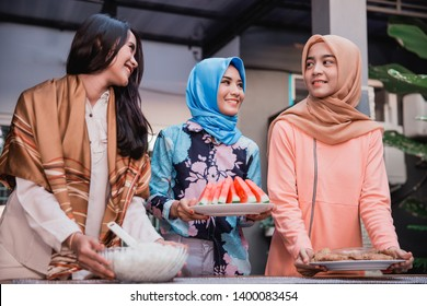 young hijab woman prepare cuisine for breaking fast serve to friends in the house at afternoon
